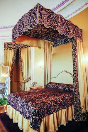 ASHEVILLE, NORTH CAROLINA - MARCH 4, 2017: Biltmore's costume exhibition. Edith Vanderbilt's oval bedroom with gorgeous canopy bed