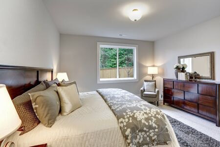 Photo for Large bedroom with nice cherry solid wood dresser, TV and huge bed. - Royalty Free Image