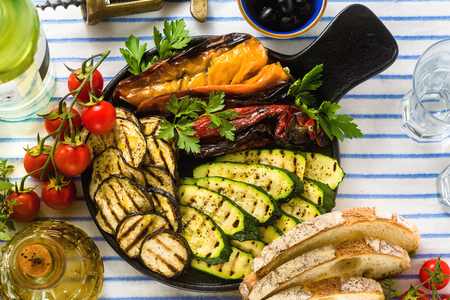 Photo pour grilled vegetables on the table with white wine, fresh bread and aromatic herbs. summer menu - image libre de droit
