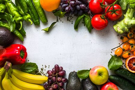 Photo pour Fresh vegetables and fruits on a white kitchen table. Background for supermarkets, fresh food stores, delivery. - image libre de droit
