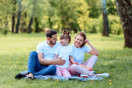 Photo for Happiness and harmony in family life. Happy family concept. Young mother and father with their daughter in the park. Happy family. Carefree, happylife. - Royalty Free Image