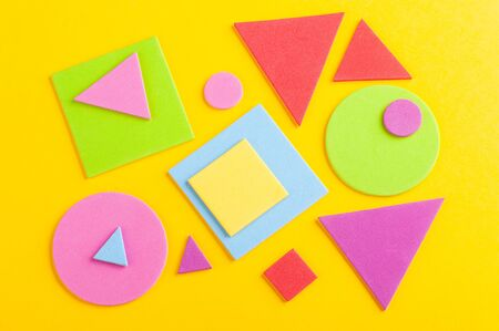 Foto de Abstract bright background of colorful geometric figures, cut from paper on yellow - Imagen libre de derechos