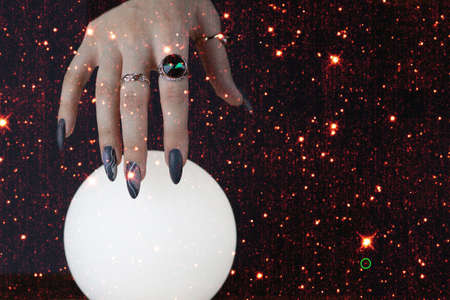 Photo pour Psychic readings and the concept of clairvoyance. Fortune telling on a crystal ball. - image libre de droit