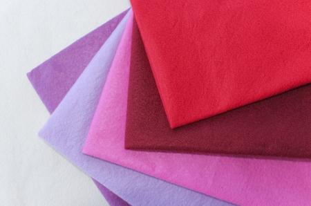 Set of 5 pieces colored felt on white felt background