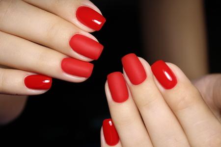 Foto de fashionable red manicure on long beautiful nails - Imagen libre de derechos