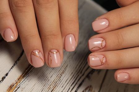 Foto de glamorous manicure of nails on beautiful female hands - Imagen libre de derechos
