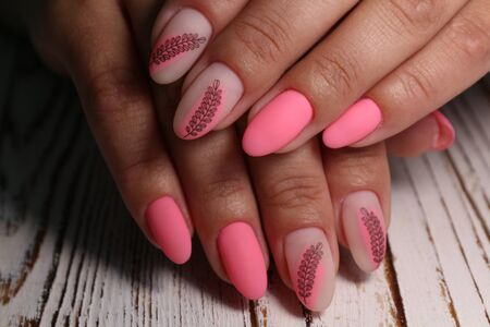 Foto de Trendy manicure design on a beautiful textural background. - Imagen libre de derechos