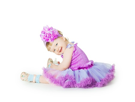 Photo for The small elegant girl with a children's small bottle - Royalty Free Image