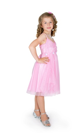 Photo pour The girl in a pink dress on a white background - image libre de droit
