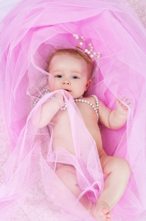 Photo for image of the little girl in a pearl crown - Royalty Free Image