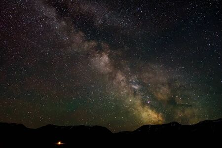 Photo pour Night panorama of the starry sky with the Milky Way galaxy, stars, nebulae and meteors in the mountains - image libre de droit