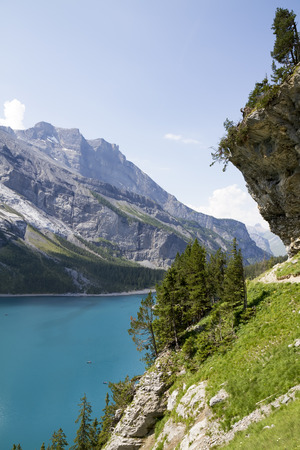 Photo pour Amazing tourquise Oeschinnensee with waterfalls and Swiss Alps, Kandersteg, Berner Oberland, Switzerland. - image libre de droit