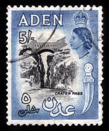 ADEN - CIRCA 1956:  stamp printed in Aden shows crater pass and image of British Queen Elisabeth. Aden became a crown colony of the UK in 1954. Circa 1956