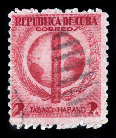 CUBA - CIRCA 1939: stamp printed by Cuba, shows Havana Cigar on the background of the globe, circa 1939