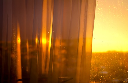 View the sunset from balcony through curtains. Abstract background