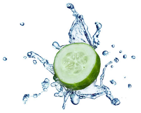 cucumber in spray of water. Juicy cucumber with splash on background