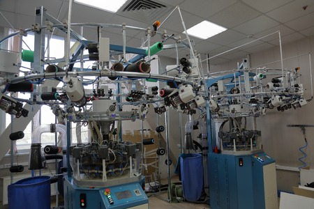 Photo pour Automatic line for sewing clothes from synthetic and knitted fabrics - image libre de droit