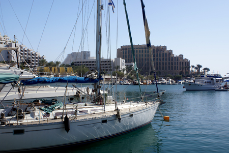 EILAT, ISRAEL - NOVEMBER 27, 2008: Yachts in the marina of Eilat on the background of hotels