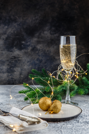 Photo for Christmas and New Year celebration with champagne. New Year holiday decorated table. Two Champagne Glasses. Holiday Decorations. Copy space. - Royalty Free Image
