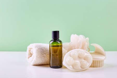 Photo pour Bathroom Accessories - Shampoo, loofah, towel and body brush. Spa composition. - image libre de droit