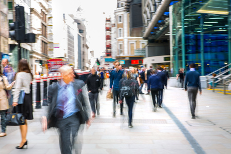 Foto per LONDON, UK - MAY 17, 2016: Business people walk through the City of London street. Blurred image. City of London business life concept - Immagine Royalty Free