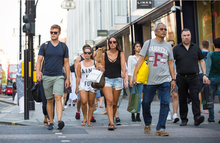 LONDON, UK -  August 24, 2016: Lots of people walking in Oxford street, one of the main shopping destination of London