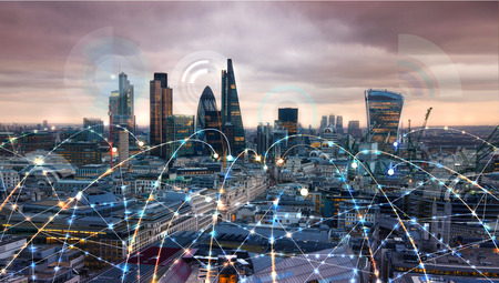 Foto de Shard of glass. City of London at sunset. Illustration with communication and business icons, network connections concept. - Imagen libre de derechos
