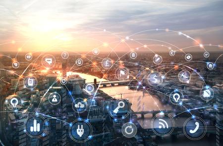 Foto de London and river Thames at sunset. Illustration with communication and business icons, network connections concept. - Imagen libre de derechos