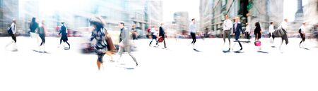 Photo pour Lots of business people walking in the City of London. Blurred image, wide panoramic view of the road with people at sunny day. London, UK - image libre de droit