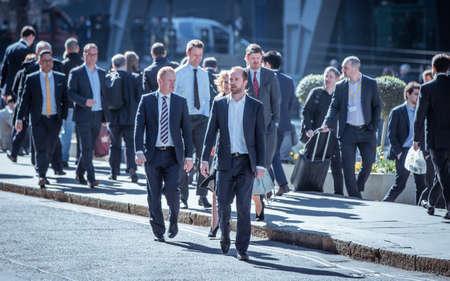 Photo pour London, UK - 20 April, 2019: Business people walking on the street City of London financial and office district. Modern business City of London life - image libre de droit