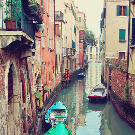 Canal with boats in Venice Italy