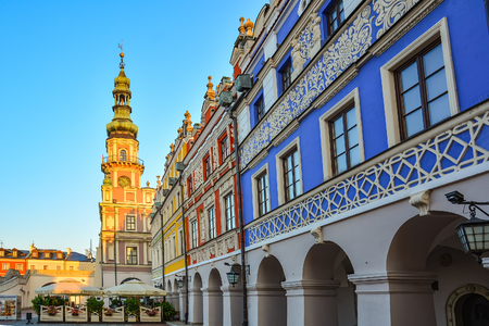 Great Market Square, Zamosc, Poland - September, 21, 2018: Zamosc town hall on Great Market Square. Large landmark city square in historical centre of town, flanked by arcaded buildings housing shops and cafes.