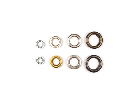 Photo pour Set of brass multicoloured metal eyelets or rivets - curtains rings for fastening fabric to the cornice, isolated on white with copyspace for text for your presentation - image libre de droit