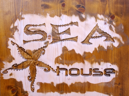 Wood carving with jellyfish and caption sea house