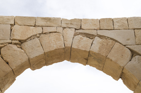 Photo for Ancient stone arch and keystone in the sky closeup - Royalty Free Image