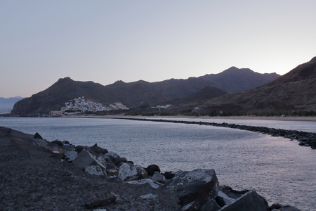 A San Andres and Santa Cruz landscape from Las Teresitas beach in the Tenerife island at the sunset