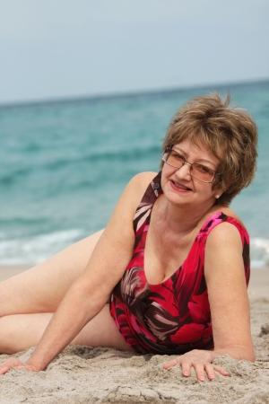 Foto für Mature woman relaxing at the  beach - Lizenzfreies Bild