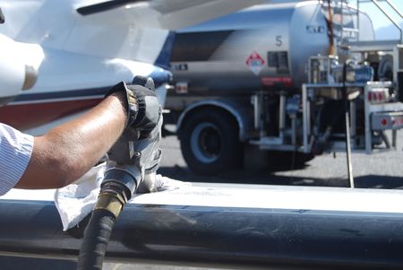 Fuel nozzle in wing filling up aircraft