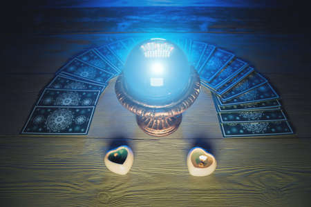 Photo pour Crystal ball and tarot cards on fortune teller table background - image libre de droit