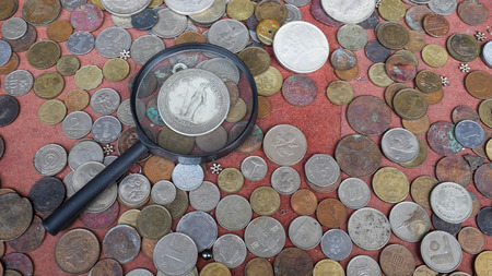 Magnifying Glass and Old Coins.