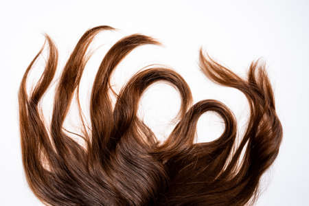 Photo for Hair waves curls lie on a white background - Royalty Free Image