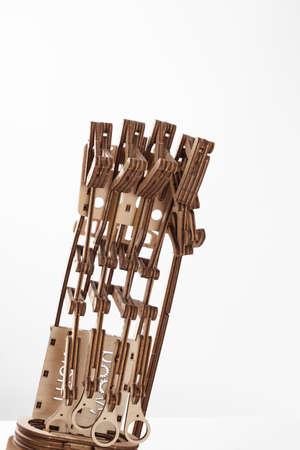 Photo pour Wooden prosthetic arm on a white background - image libre de droit