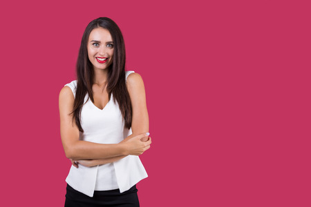 Smiling and slightly embarrassed business woman is holding her elbows and looking confused. Concept of socially awkward person. Mock up