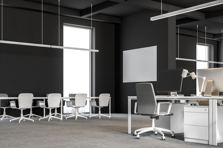 Corner of a modern international company office with dark gray walls, and computer desks standing in rows. Industrial style. Banners on walls. Meeting room 3d rendering mock up