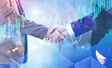 Photo pour Two unrecognizable businessmen shaking hands over abstract background with glowing graphs interface in the foreground. Stock market concept. Toned image double exposure - image libre de droit