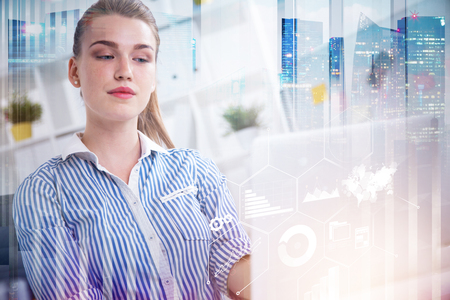 Beautiful blonde businesswoman working in office. Infographics interface foreground. Cityscape background. Toned image double exposure. Elements of this image furnished by NASA