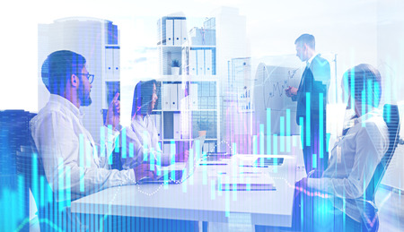 Business team making a presentation in their office with double exposure of modern cityscape and graph in the foreground. Toned image