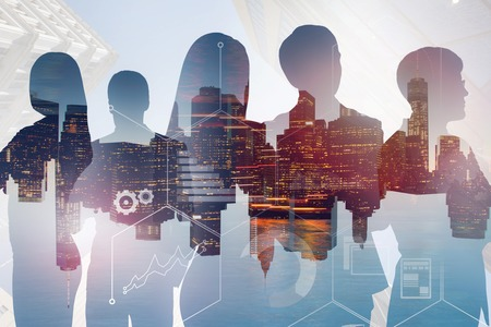 Photo pour Silhouettes of business people over night cityscape background with double exposure of business infographics. Toned image - image libre de droit