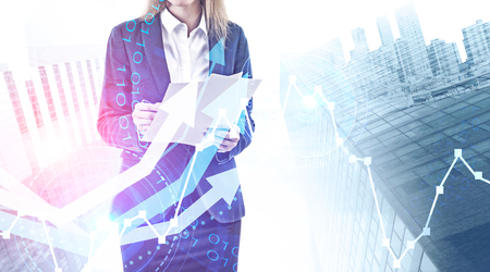 Businesswoman with papers over abstract city background with rising graph and HUD interface. Concept of trading and investment. Toned image double exposure