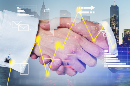 Close up of two businessmen shaking hands over cityscape background with graphs and business infographic. Concept of partnership. Toned image double exposure
